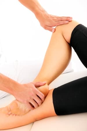 A woman going through foot therapy exercises